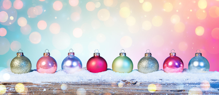 Colorful Baubles On Snow In Shiny Background Archivio Fotografico - 114447958