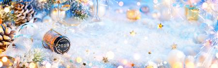 2019 Happy New Year - Champagne Cork On Snow Archivio Fotografico - 114447965