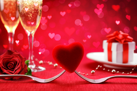 Romantic Dinner - Fork And Heart With Defocused Gift And Champagne - Valentine's Day Background Archivio Fotografico - 116640072