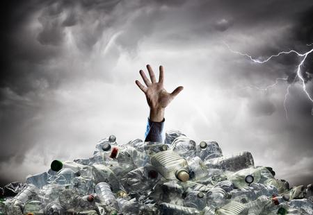 Plastic Pollution - Man's Hand In Plastic Sea - Environmental Problem Archivio Fotografico - 119611316