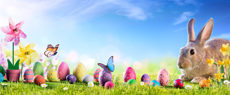 Easter - Cute Bunny With Eggs In Meadow Archivio Fotografico - 119611272