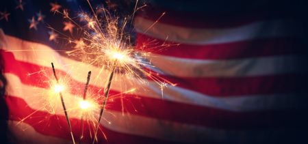 Vintage Celebration With Sparklers And Defocused American Flag - Independence Day Archivio Fotografico - 125945044