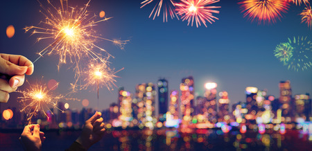 Vintage Abstract Celebration With Bokeh - Blurred City Light At Twilight And Sparklers Archivio Fotografico - 125945046