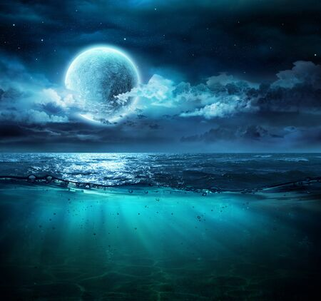 Moon On Sea In Magic Night With Underwater Scene Фото со стока