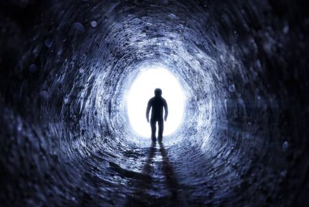 Senior Man Walking To The Light At The End Of The Tunnel - Hope After Life