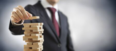 Business Planning And Strategy - Businessman Construct A Tower With Toy Blocks