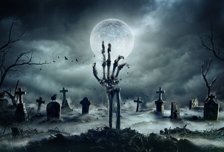 Skeleton Zombie Hand Rising Out Of A GraveYard - Halloween