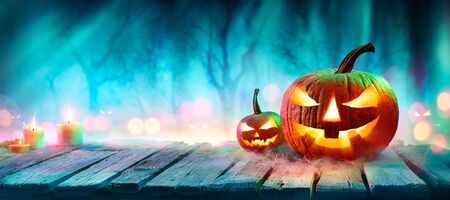 Jack O? Lanterns In Spooky Forest With Ghost Lights - Halloween Background