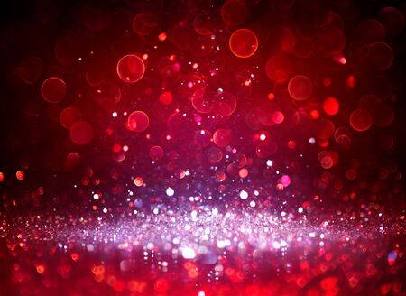 Sparkling Silver Glitter In Red Blurred Background