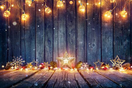 Christmas Decoration With Stars And String Lights On Rustic Wooden Table Imagens
