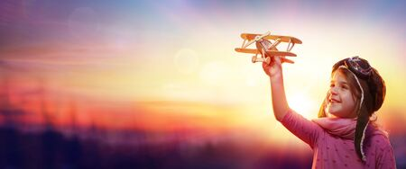 Child Play With Airplane At Sunset-Imagination And Freedom Concept