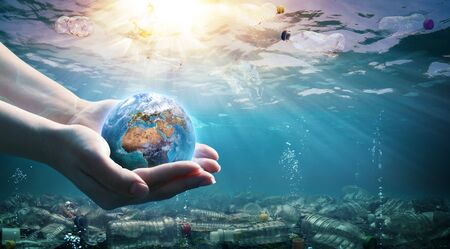 Plastic Waste In The Environment - Ocean Pollution- Hands Holding Earth