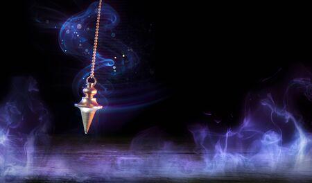 Esoteric And Hypnosis Concept-Pendulum Swinging With Magic Smoke