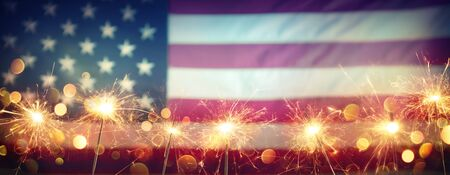 Use Celebration With Sparklers And Blurred American Flag On Vintage