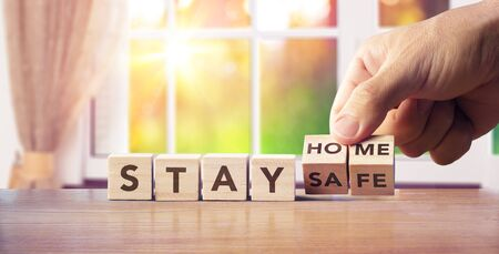 Stay Home Quarantine Concept Hand Turn Wooden Blocks With Text Message