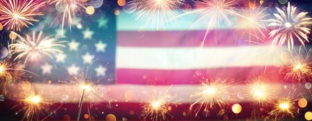 Use Celebration With Sparklers-Fireworks And Blurred American Flag On Vintage Background