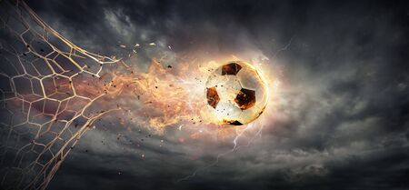 Goal - Fiery Soccer Ball breaking Through The Net With Dramatic Sky