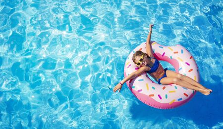 Funny Child On Inflatable Donut In Pool