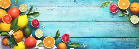 Assorted Fresh Citrus Fruit On Wooden Table - Lemon Orange Lime In Top View