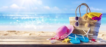 Beach Bag On Seashore With Accessories - Summer And Sea