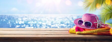 Beach Accessories On Table With Shiny Sea On Background