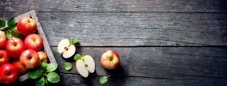 Ripe Apples In Wooden Box On The Vintage Table