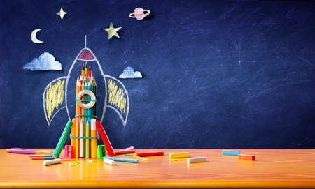 Startup Concept - Rocket Sketch On Blackboard With Colorful Pencils - Back To School