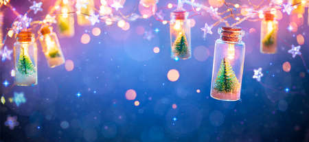 Abstract Christmas Card With Defocused Vintage Effects - String Light With Trees In Glass Jars Decoration
