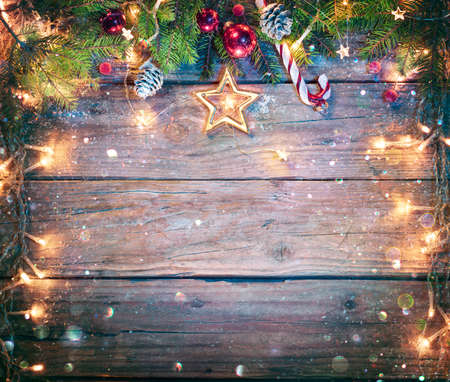Rustic Christmas Board - Fir Branches And String Light On Wooden Plank With Defocused Abstract Snowfall
