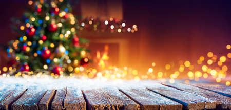 Abstract Christmas - Snowy Table With Bokeh Lights And Defocused Christmas Tree