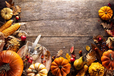 Thanksgiving Board - Table Setting With Silverware And Pumpkins On Aged Wooden Plank Stok Fotoğraf