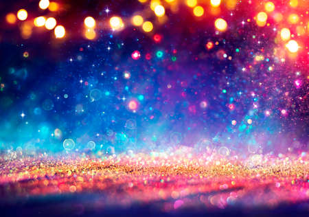 Abstract Defocused Christmas Background - Shiny Golden Glitter With Blurred Lights On Blue Background