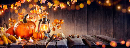 Thanksgiving - Old Table With Pumpkins And Corns With Bokeh Lights In Dark Background