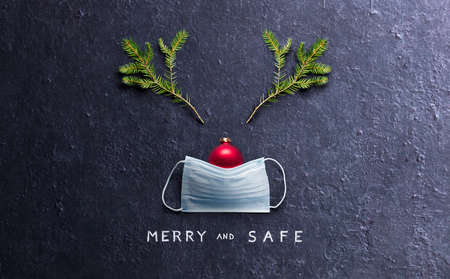 Minimal Christmas Concept - Merry And Safe - Reindeer Made With Face Mask And Decorations Stok Fotoğraf