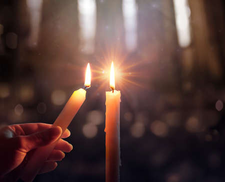 Defocused Hope Concept - Hand Igniting A Candle With Shining Flame And Blurry Lights Stok Fotoğraf