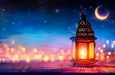Muslim Holy Month Ramadan Kareem - Arabic Lantern With Burning Candle And Bokeh Glowing At Evening