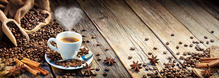 Coffee Espresso Cup With Beans And Cinnamon On Wooden Table 写真素材