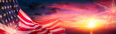 American Flags At Sunset With Fireworks - Abstract Defocused Composition 写真素材
