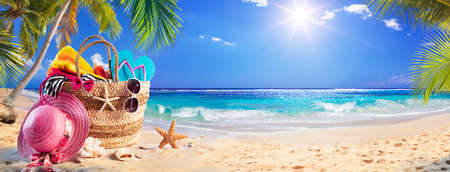 Beach Bag On Tropical Sand With Palm tree and Sunny Sea 写真素材