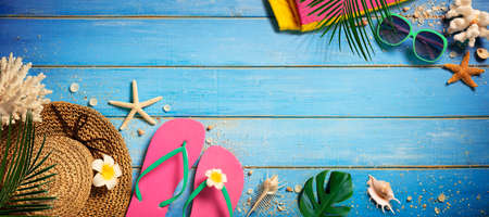 Beach Accessories On Blue Wooden Plank - Vacation Concept