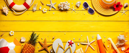 Yellow Beach Background With Accessories On Wooden Table