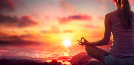 Yoga At Sunset - Woman In Meditation - Focus On Foreground And Blurred Background