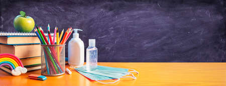 Back To School - Stationery With Covid-19 Protective Mask And Sanitizer 写真素材