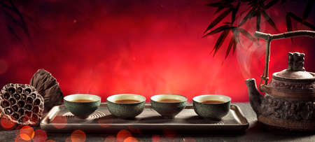 Tea - Japanese Ceremony With Hot Teapot And Teacups On Red Background 写真素材