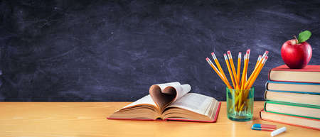 Back To School With Love - Books And Pencils With Apple In Classroom