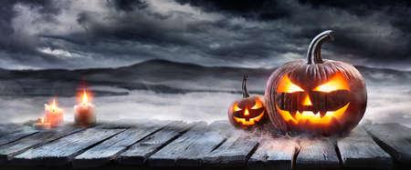 Halloween Pumpkin On Table In A Fog Landscape