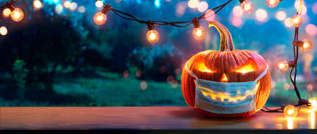 Pumpkin With Protective Mask - Halloween In Outdoor 写真素材