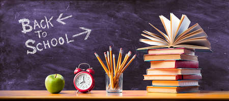 Back To School Concept - Time To Study - Apple and pencils With Stack Books And Clock Alarm