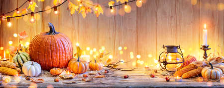Pumpkins On Wooden Table - Thanksgiving Background With Vegetables And Bokeh Lights 写真素材