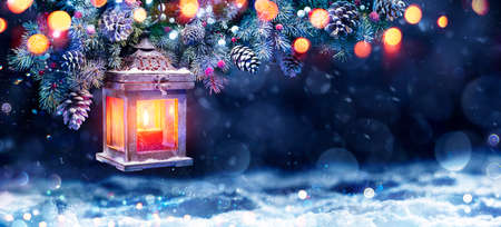 Christmas Lantern In Night With Snow And Fir Branch